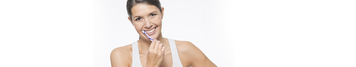 Preventive Dentistry Oakville - woman brushing her teeth